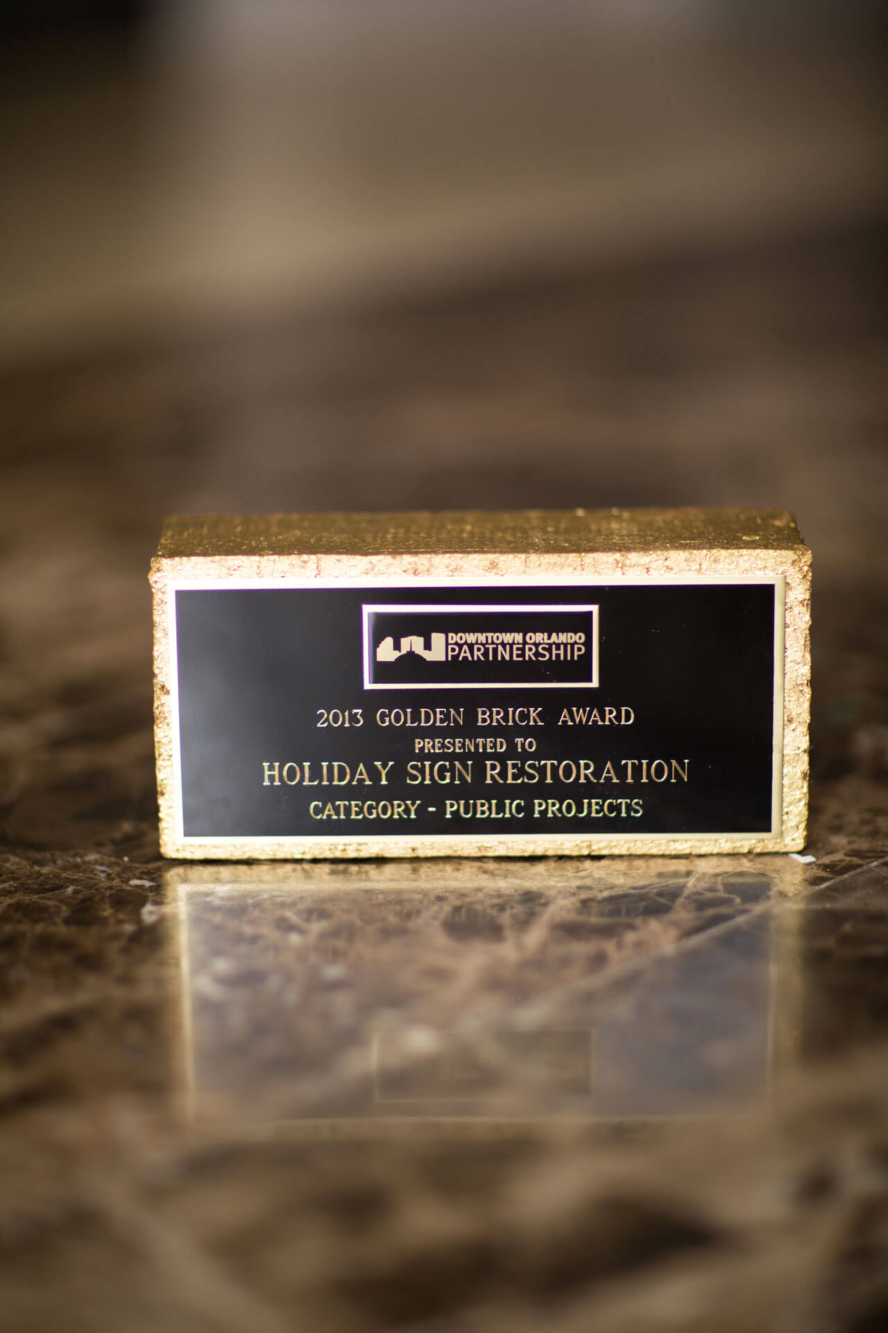 Golden Brick Award - Holiday Sign Restoration - Ivanhoe Village - Orlando FL